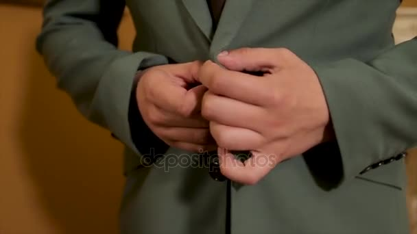 Making business look good. Close-up of man buttoning his jacket. Confident young businessman buttoning suit