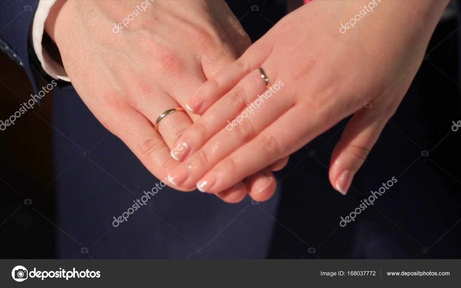 Newly wed couples hands with wedding rings Bride and groom with