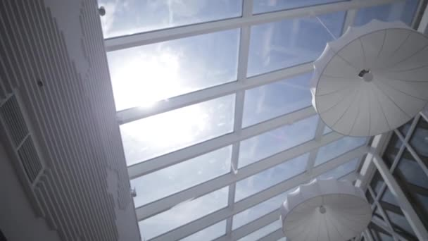 Viiew of the sun and blue sky through the window slide motion. Skylights. View from the window. View of the sky from the window. Window on the roof. Sunlight through the roof. Light in the house