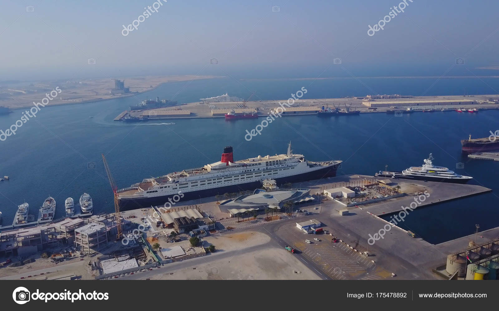 Huge Cruise Ship Is On The Water Aerial View Of Dubai Seaport - Huge cruise ship
