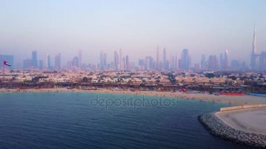 Dubai skyline view from coast or beach with city landscape and skyscrapers with Burj Khalifa background. Amazing aerial view of Dubai from Burj Khalifa tower. Panoramic scene.
