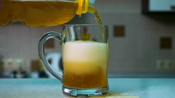 Cinemagraph - Pouring Beer. Chilled green bottle with condensate and a glass of beer lager. Beer pouring into mug in a bar. Pouring beer in glass on bar or pub desk