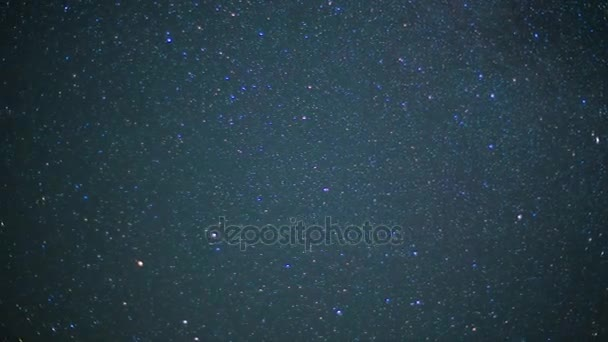 Beautiful night sky and stars with meteor or shooting star as background. Video. Animation of a starry sky with falling stars