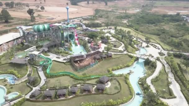 Slider in swimming pool. Video. The water slide structure. Long colorful water slides in aquapark at summer. Aerial