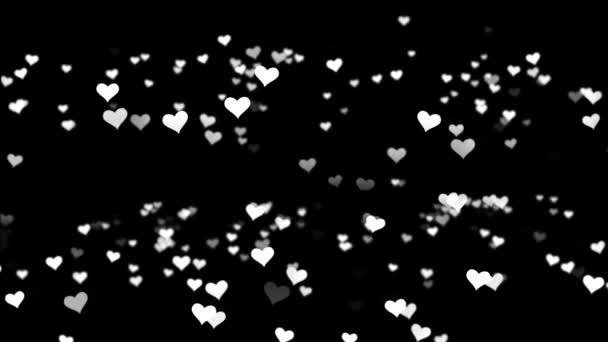 rote kleine Herzen auf schwarzem Hintergrund. Valentinstag Urlaub abstrakte Schleifenanimation. Animation von Herzen auf schwarzem Hintergrund