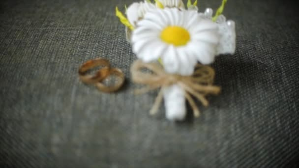 Engagement rings and wedding bouquet of flowers. Clip. Bouquet of flowers and beautiful wedding rings