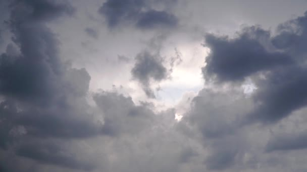 Background of dark clouds before a thunder-storm. Clip. Clouds and clouds in cloudy weather. Dramatic scene