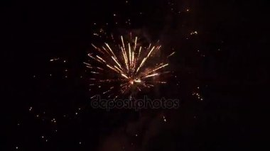 Beautiful colorful holiday fireworks in night sky. Clip. Fireworks in the night sky. Holiday concept