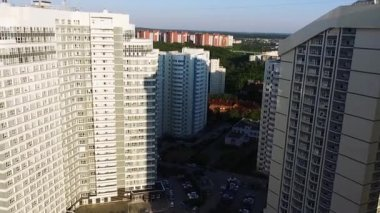 Panorama of a modern residential complex. Clip. High-rise buildings at sunset. Corporate building in city