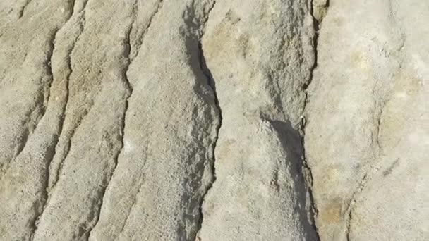 Close-up detail of rough cut miniature rocky cliffs. Nature and adventure concept. warm limestone texture. close up texture of grey stone with cracks