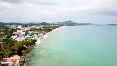 Aerial view on coastline, sea and waves. Video. Top View of a drone at the Beach. Top view of an amazingly beautiful sea landscape with turquoise water.