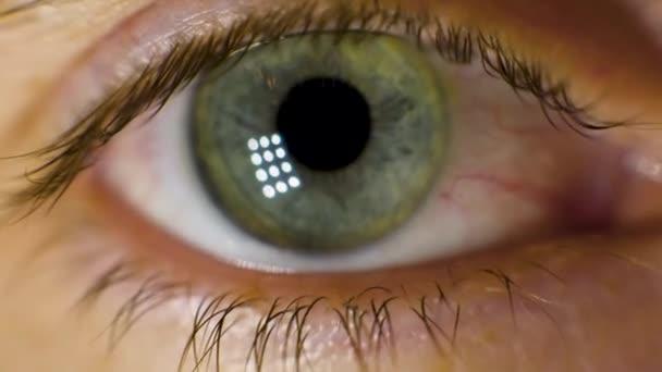 Extreme Macro of a brown eye. Video. Closeup of mans eye. spot in the eye. macro. High dynamic range and macro shot hazel eye