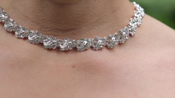 Set of footages with Wedding necklace close up. 2 in 1. Chest of beautiful bride wearing pearl Necklace. Close up of a bridal necklace.
