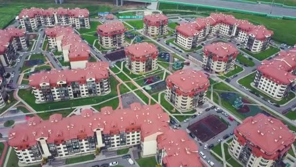 Top view of luxury suburban apartment complex. Clip. Aerial view apartment buildings complex and residential houses neighborhood