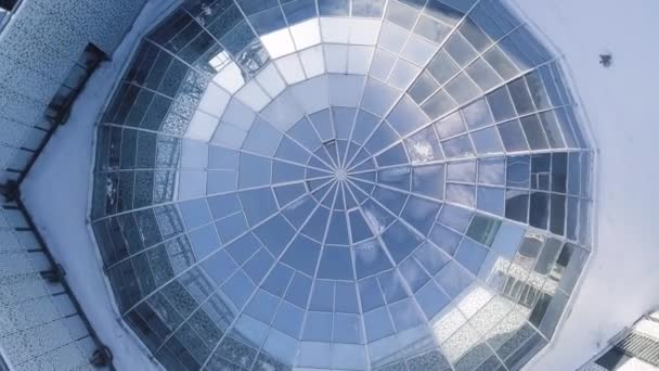 Top view on Structural glass facade curving roof of fantastic office building. Modern and Contemporary architectural fiction with glass steel column. Glass dome and sun. Top view on glass construction