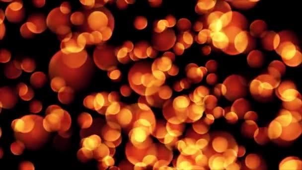 Abstraktní bokeh zlatých částic. Bezešvá smyčka abstraktní pozadí z kruhů bokeh a částic v modré a oranžové