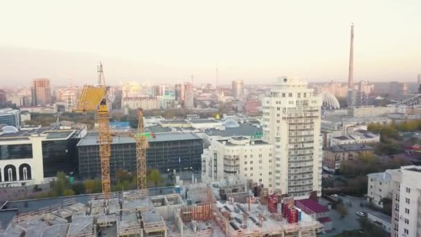 Aerial view of construction site with crane and building. Video. Top view of big development construction and architecture