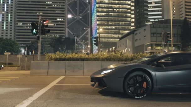 Amazing sports car in city at the traffic light at night. Stock. Night view of the sports car at the traffic light