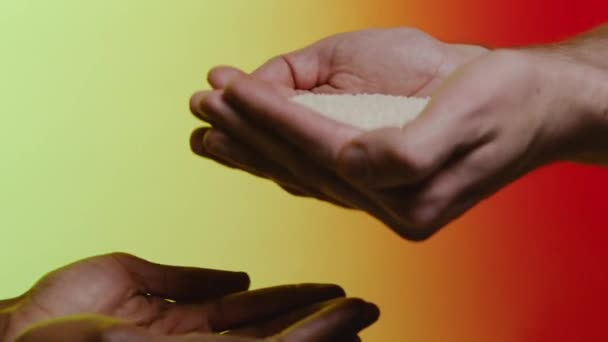 Support concept. Stock. Empathy, compassion, help, kindness. Humanitarian assistance to African countries. Hands pour rice into the hands of a black man
