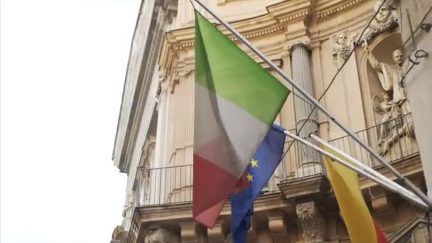 Flag of Italy and Europe Union Flag on the old roman building