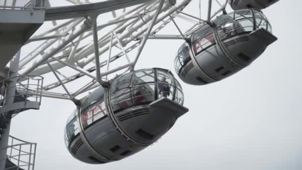London, England - October, 2019: Big wheel cabins. Action. The London Eye is a giant Ferris wheel on the Thames River Embankment. Cabin of the Ferris wheel in London