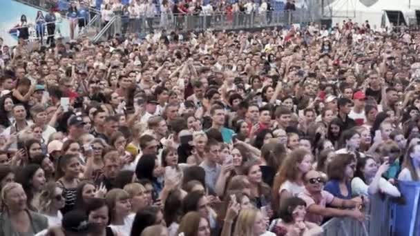 Finland - Helsinki, 08.16.2019: people recording concert with mobile phones. Action. Crowsd of people enjoying the perfomance.