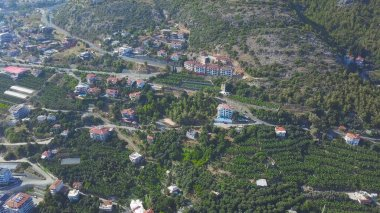 Aerial of the sunny Alanya in Antalya Province, Turkey. Art. Obeservation deck I love Alanya on a green mountain slope, tourism and summer vacation.