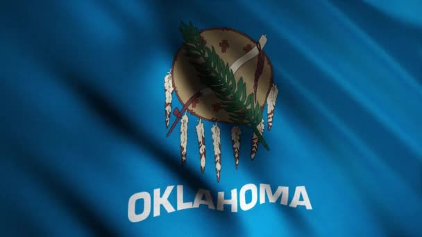 Close-up of waving Oklahoma flag. Animation. Patriotic background flag is rectangular blue color with image in center of Indian appliances. Flags of States of America