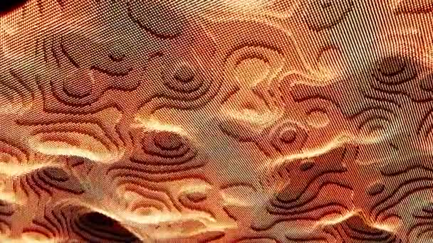 Wavy surface with ripples and grains, seamless loop. Animation. 3D vibrant pixel texture of orange color, futuristic and technological background.