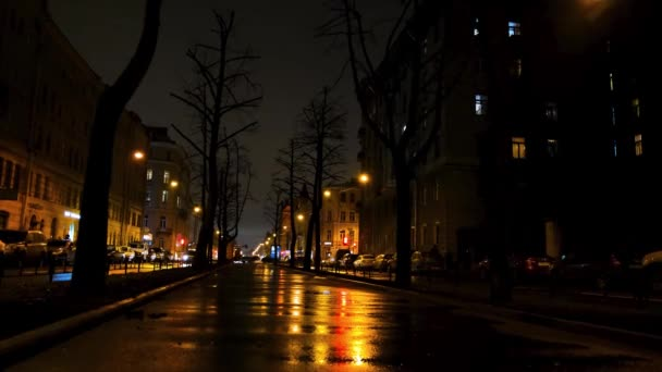 Beautiful night in the big city and the street under the lights of yellow lanterns. Concept. City alley with moving cars.