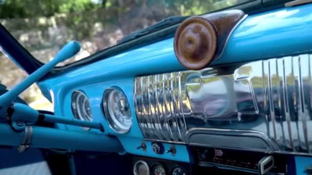 Vintage retro car interior. Action. Beautiful design of a blue retro car. Interior of the car
