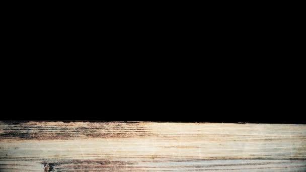 Abstraktní dřevo textury pozadí. Animace. Dřevěné prkna s prasklinami a skvrnami na černém pozadí, pohybující se nahoru.