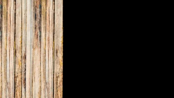 Background of vertical wooden boards appear on black background. Animation. Concept of construction of natural materials, moving parallel wooden planks.