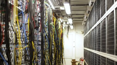 Fiber optic equipment in a data center, IT and modern technologies concept. Stock footage. Server room routers and fiber optical cables.