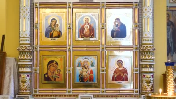 Detailed icons in Russian Church. Stock footage. Close-up beautiful images of angels and sacred faces on icons inside Church