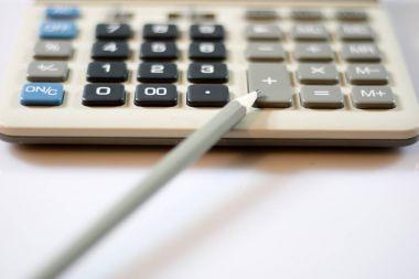 Documents, calculations, calculators, calculator and pen and pen