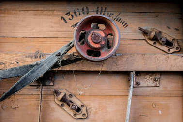 Old pulley in an old agricultural machine. Threshing machine, pu