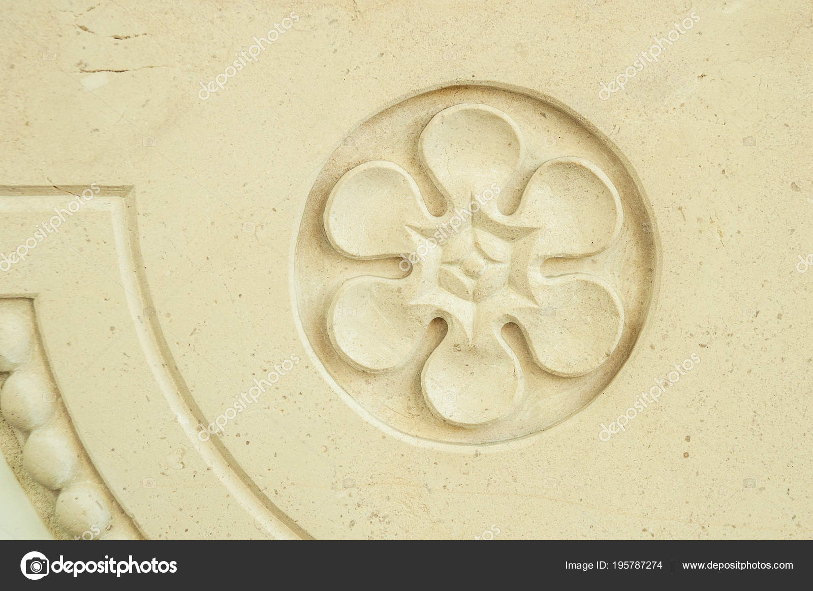 Old plaster bas relief in the form of a flower in a round frame