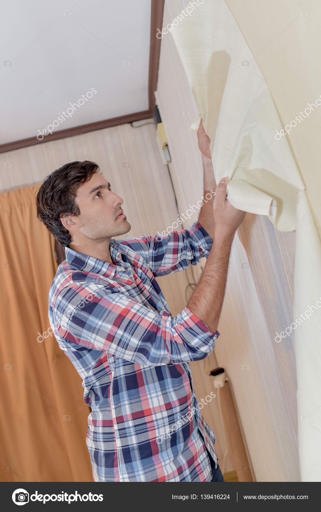 Removing Old Wallpaper And Apartment Stock Photo