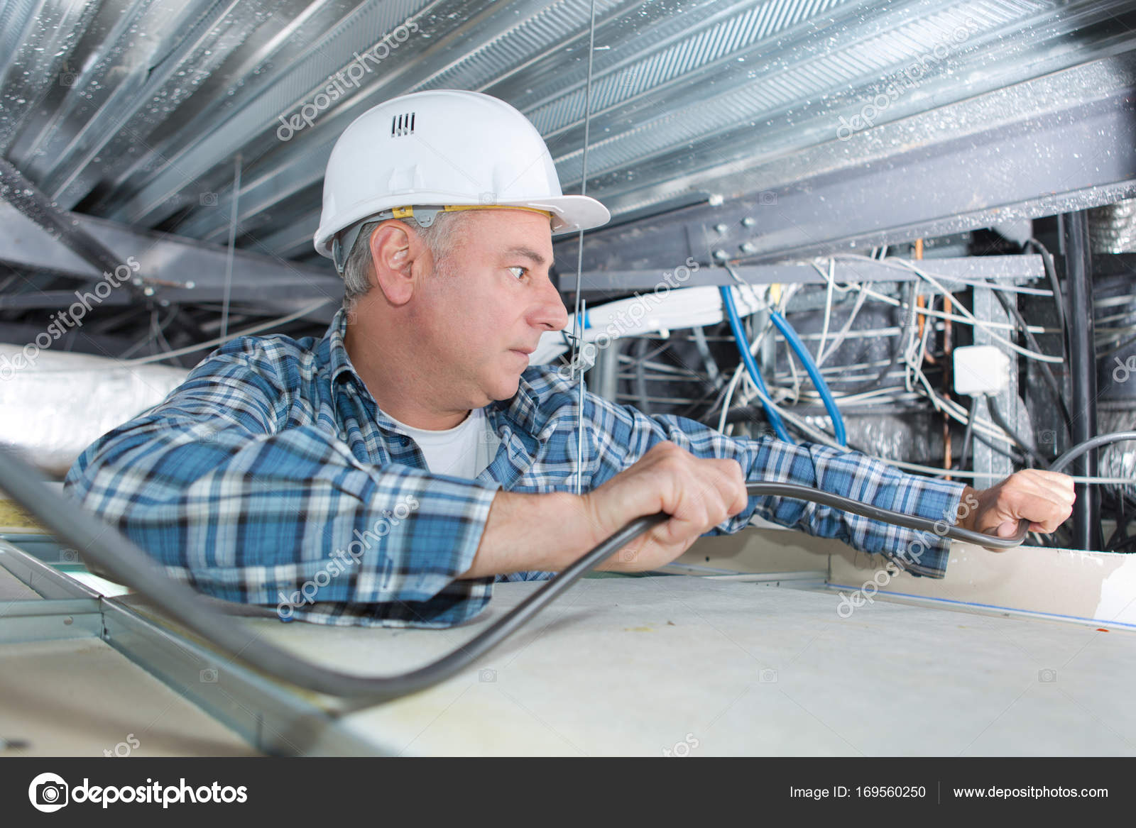Middle Aged Electrician Installing Cable Stock Photo Wiring Contractor