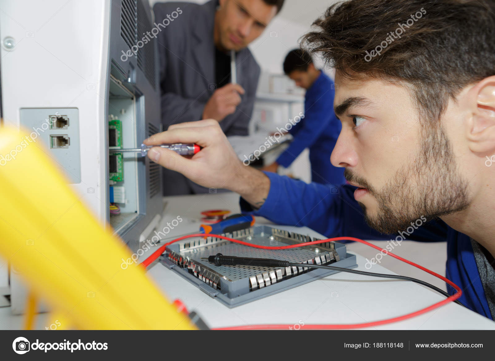 Engineer training male apprentice on cnc machine — Stock