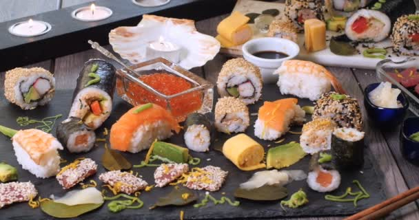 Dolly view of an assortment of Japanese food: sushi, nigiri, sashimi