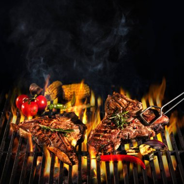 Beef T-bone steaks on the grill