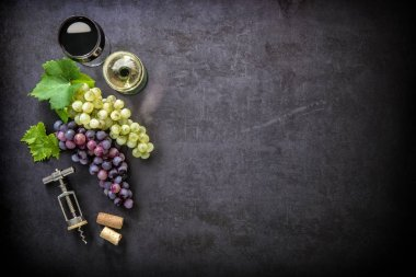 Wineglasses with grapes and corks