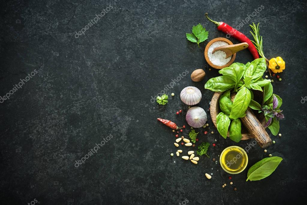 Herbs and spices on black stone table