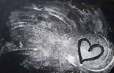 Baking background with heart shape and flour on the dark table