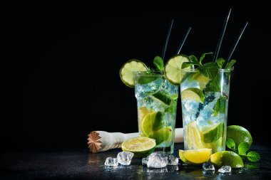 Two glasses of mojito cocktail with fresh lime and mint