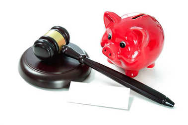 Judges court gavel and piggy bank with an empty tag