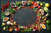 Photo Colourful background of various herbs and spices in bowls for cooking with copy space for your text
