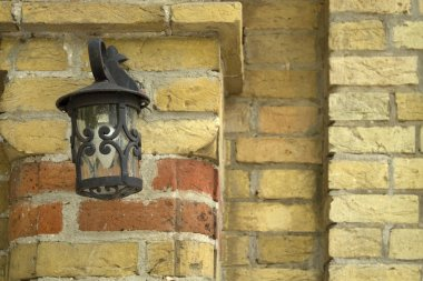 Vintage lantern on the background of the old brick wall